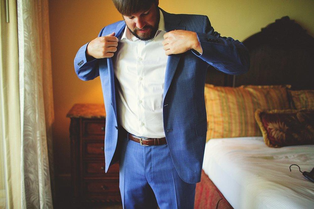 pierre's restaurant wedding: groom putting on jacket