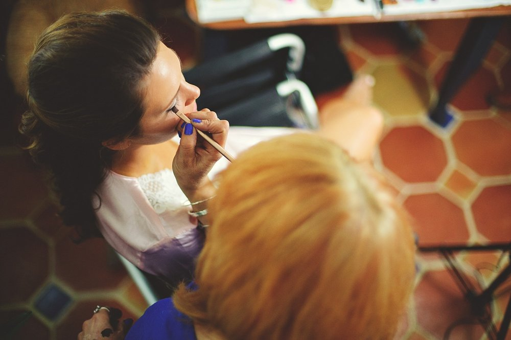 pierre's restaurant wedding: bride getting makeup done