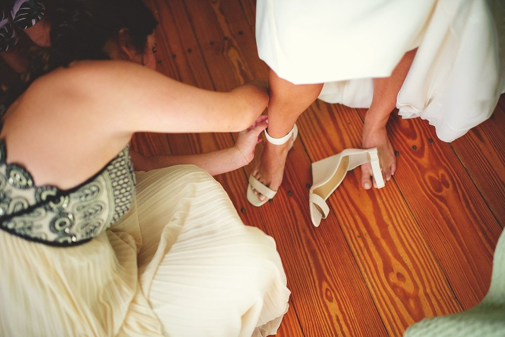 pierre's restaurant wedding: putting on shoes
