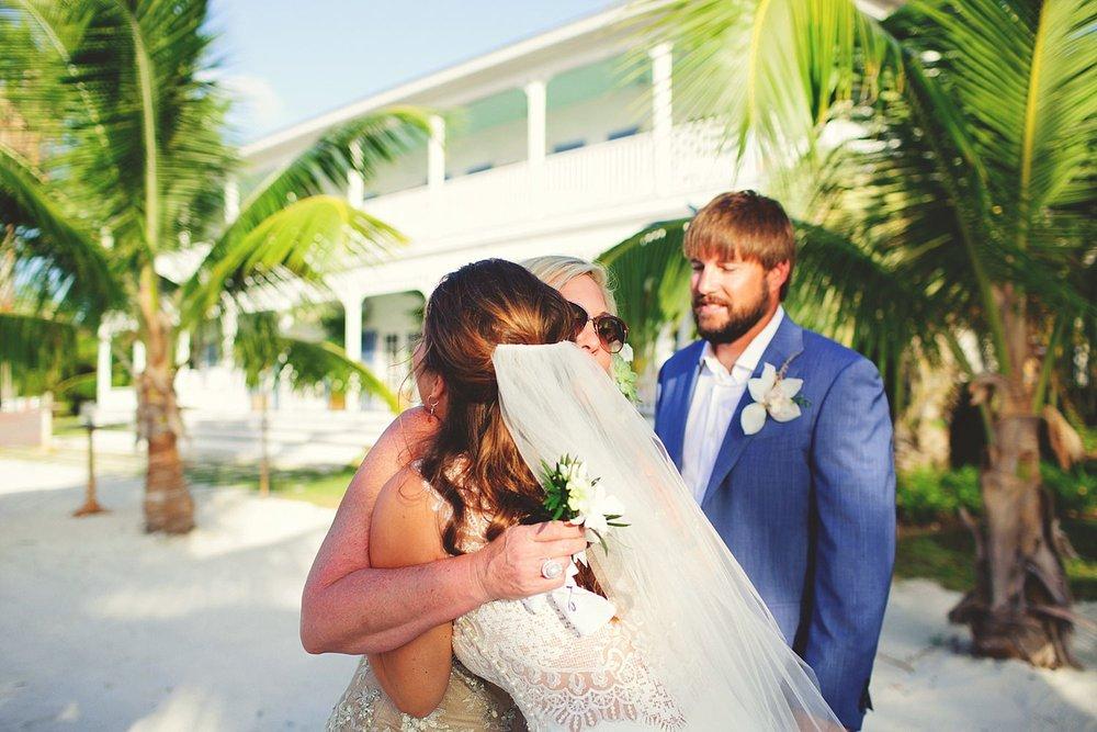 pierre's restaurant wedding: bride hugging family