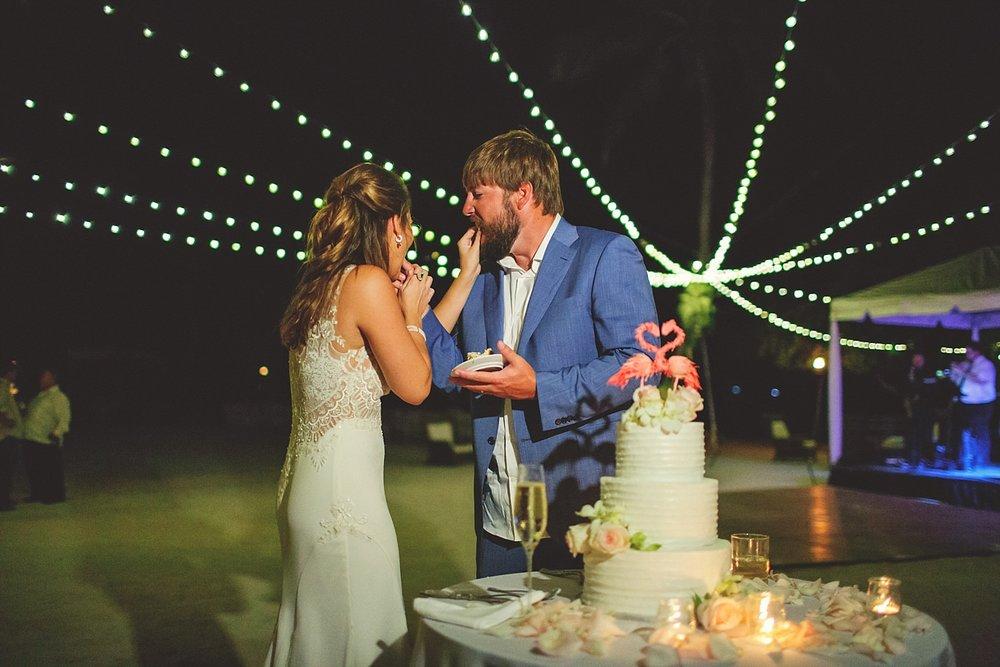 pierre's restaurant wedding: feeding cake to each other
