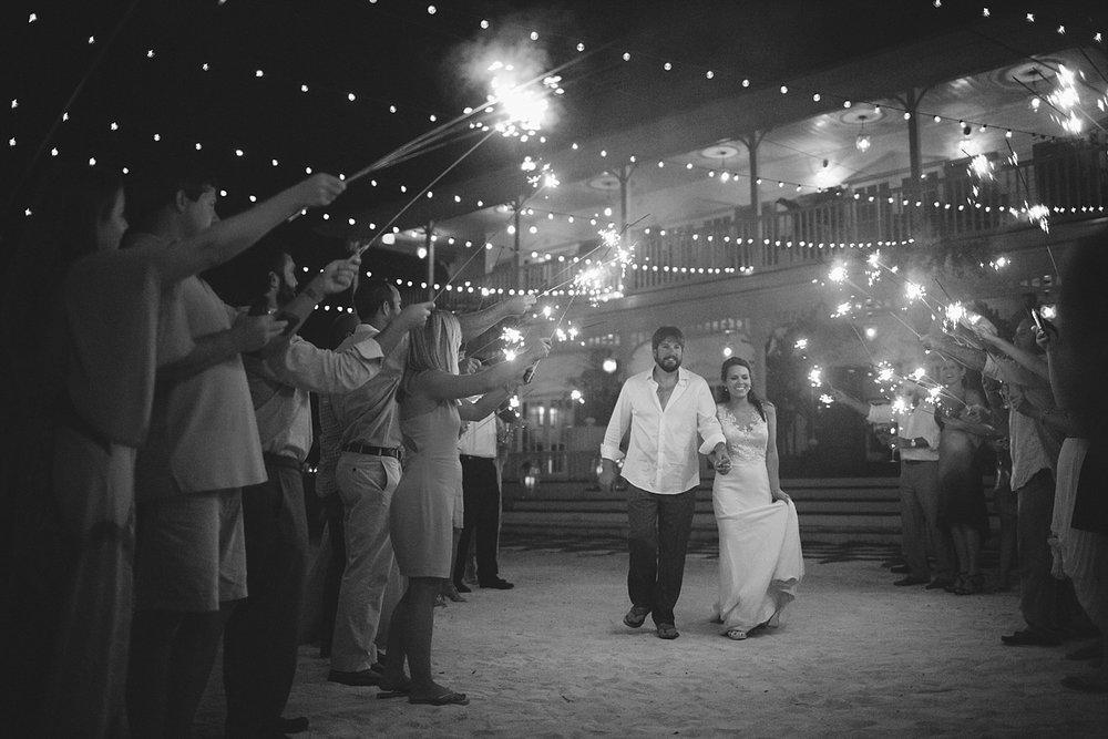 pierre's restaurant wedding: sparkler exit on the beach