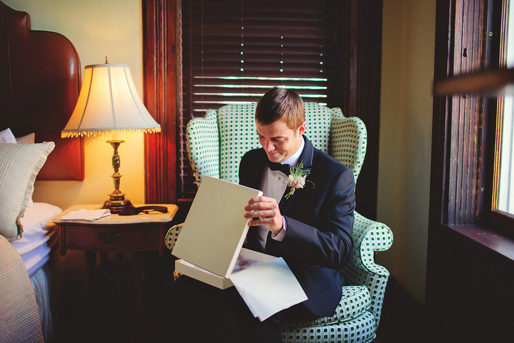 Harper Fowlkes House wedding: groom opening gift