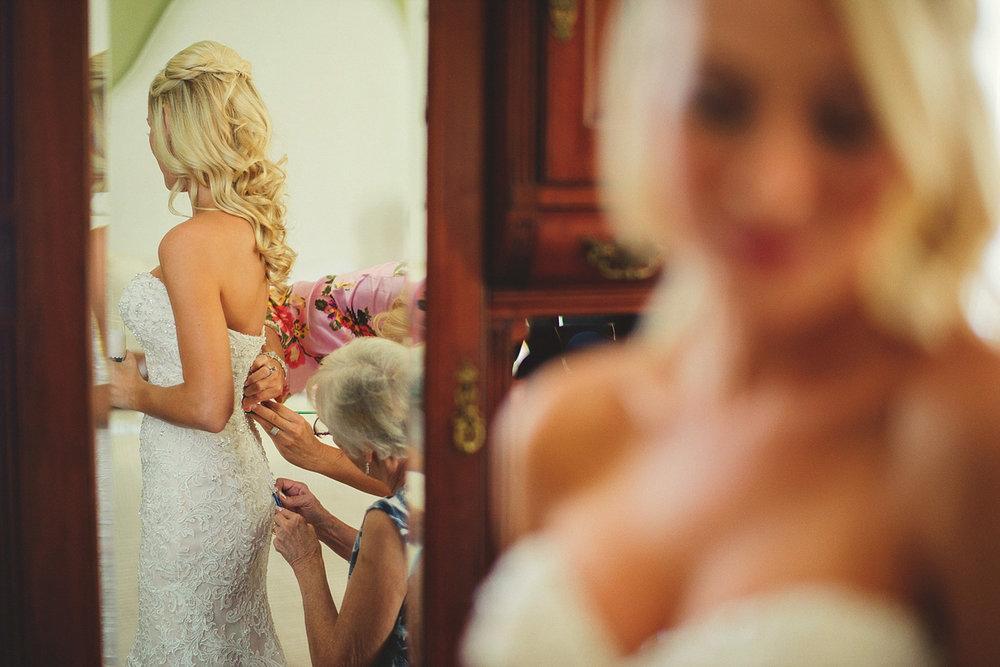 Harper Fowlkes House wedding: buttoning wedding dress