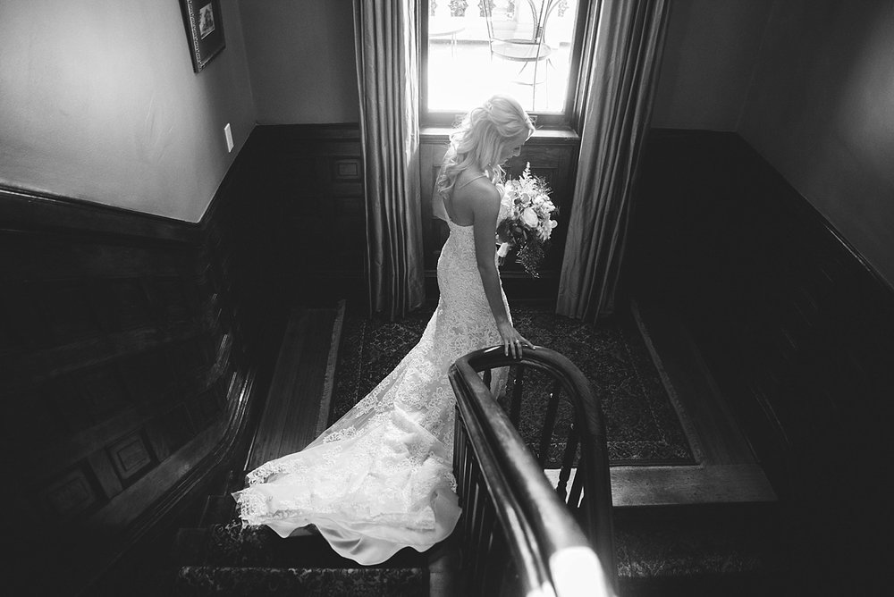 Harper Fowlkes House wedding: bride going down stairs