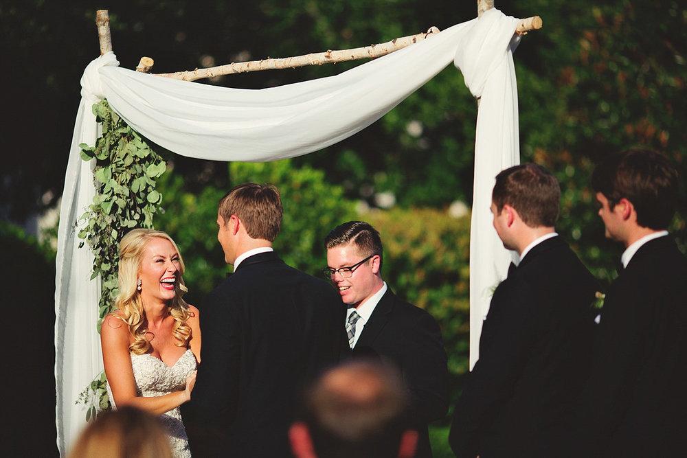 Harper Fowlkes House Wedding: bride laighing