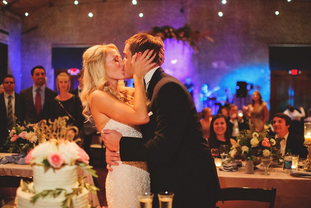 Chalres Morris Center Wedding: cake kissing