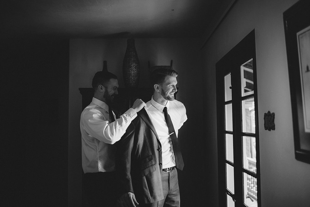 casa feliz wedding photos: groom puttting on jacket