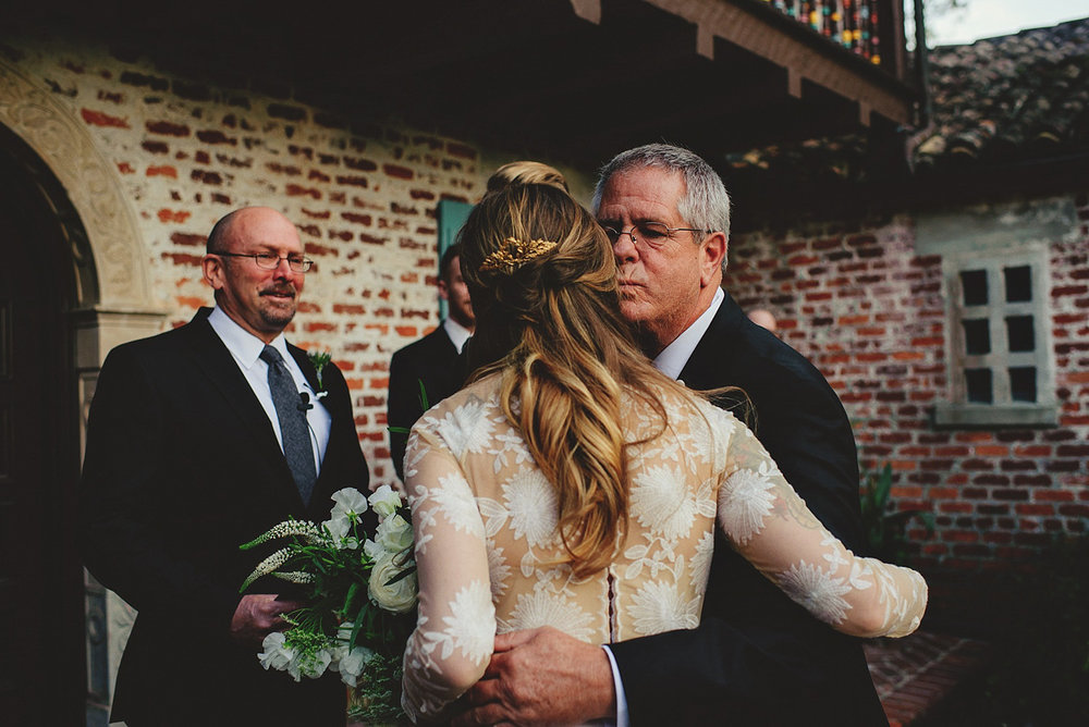 casa feliz wedding photos: dad kissing bride away