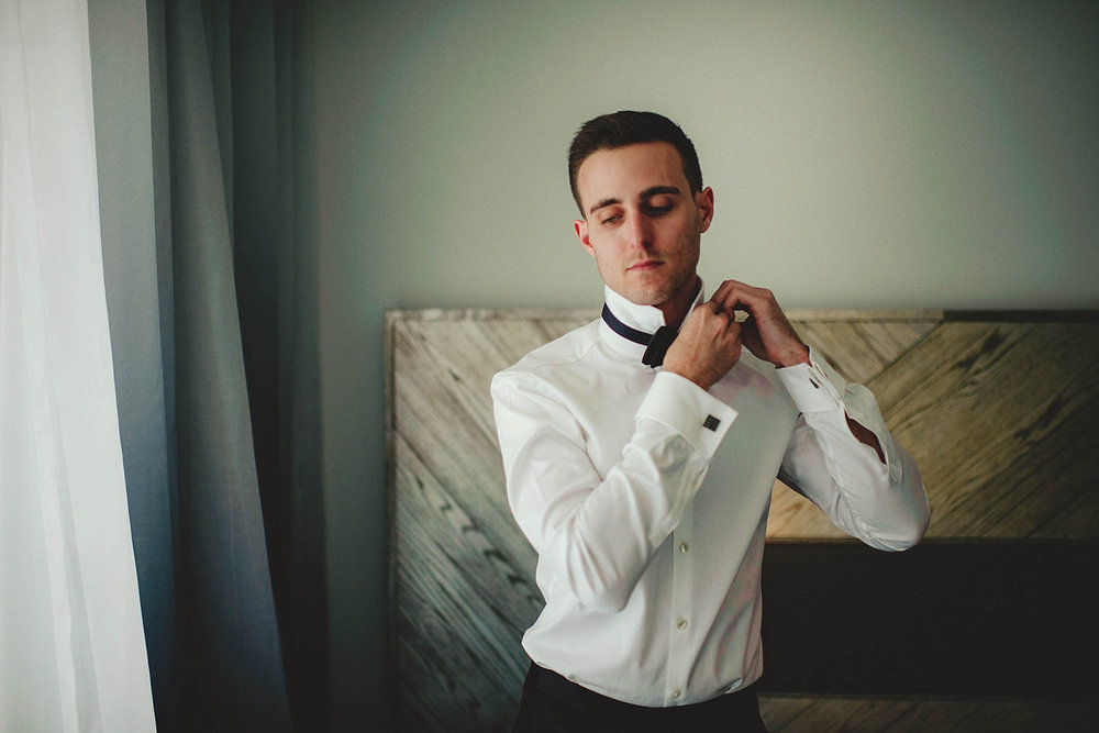 romantic-w-fort-lauderdale-wedding: groom putting on bow tie