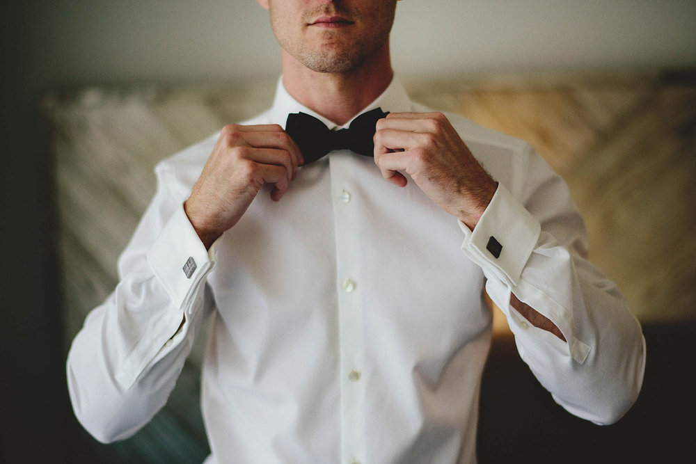 romantic-w-fort-lauderdale-wedding: groom straighting bow tie