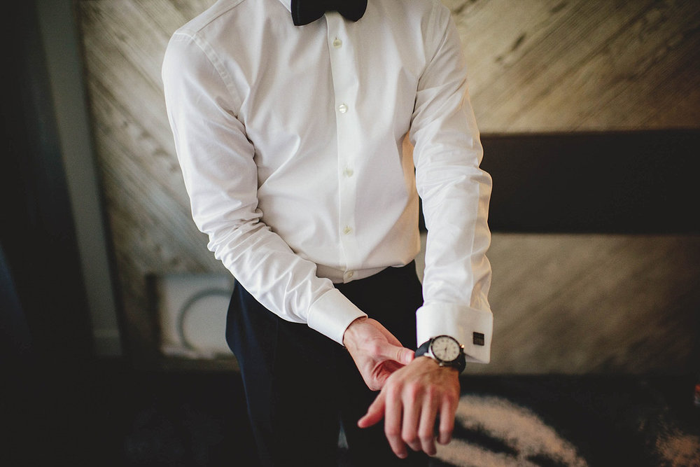 romantic-w-fort-lauderdale-wedding: groom putting on watch