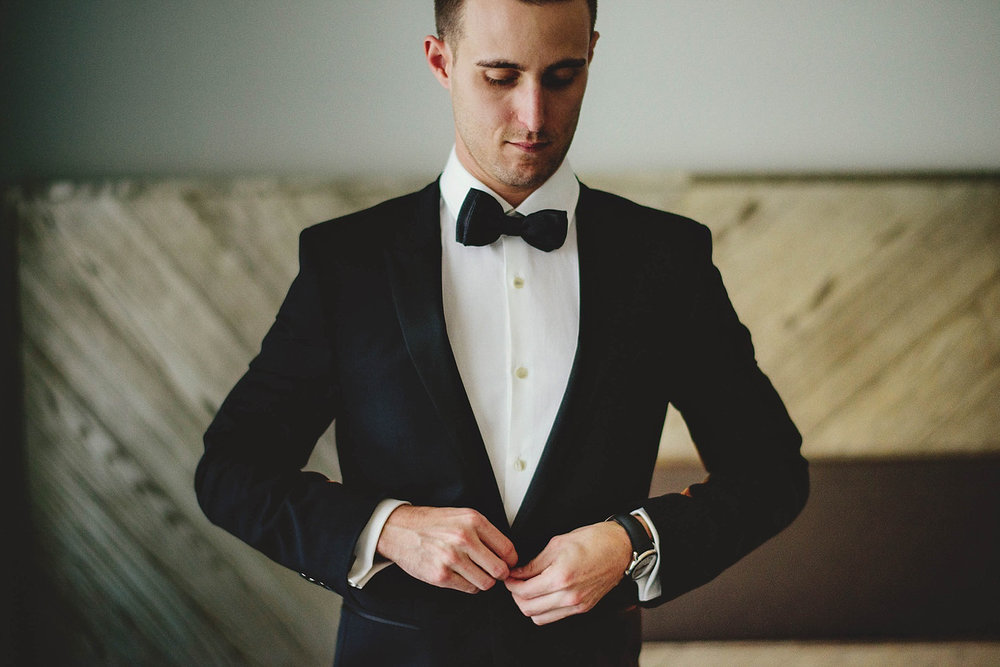 romantic-w-fort-lauderdale-wedding: groom buttoning jacket