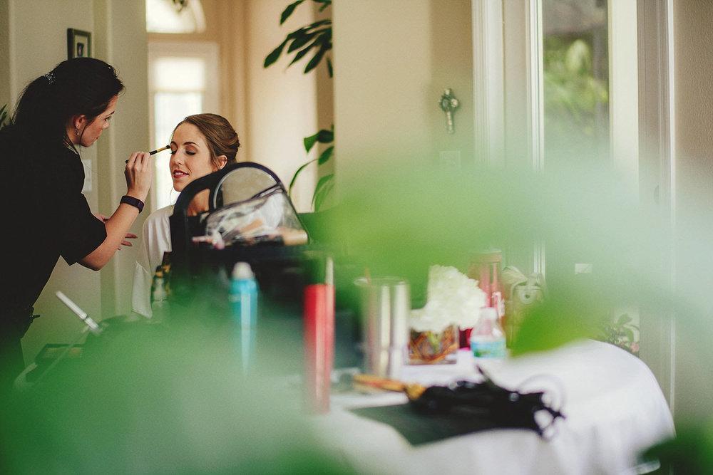 knowles memorial chapel wedding: bride getting makeup