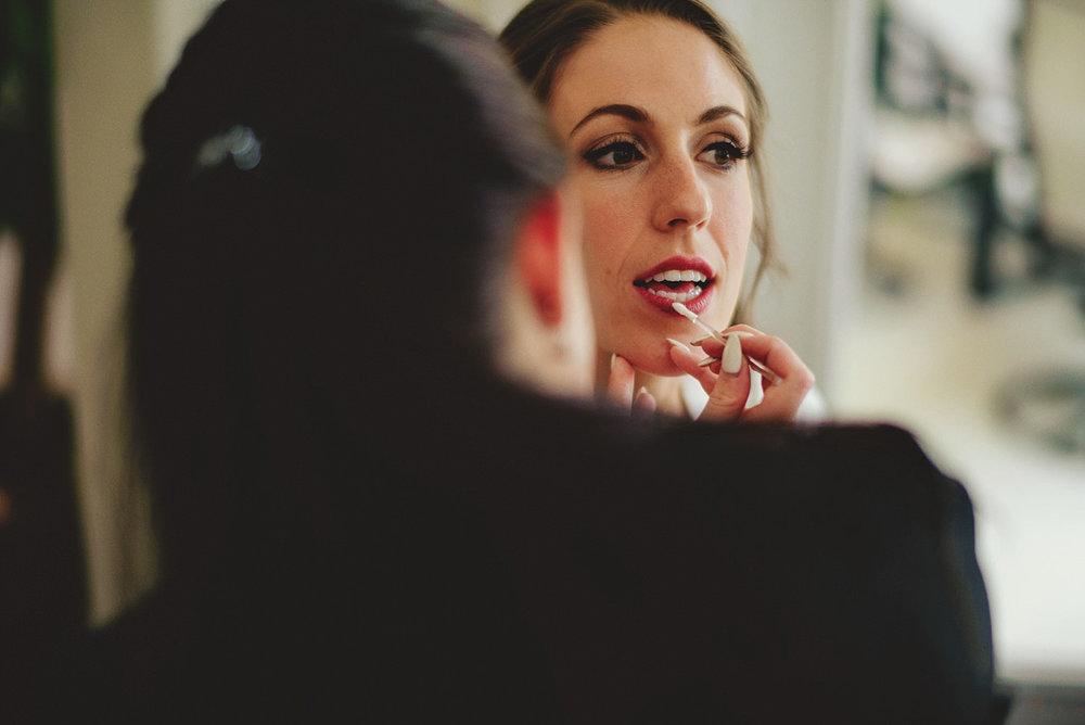 knowles memorial chapel wedding: bride getting lipstick