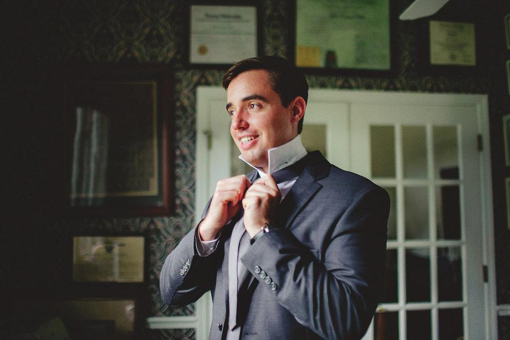 knowles memorial chapel wedding: groom tying tie