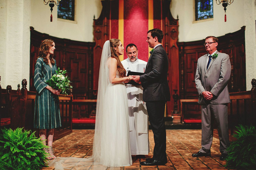 knowles memorial chapel wedding: holding hands in ceremony