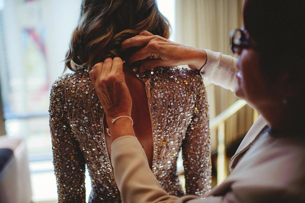 golden nugget wedding - mom zipping dress