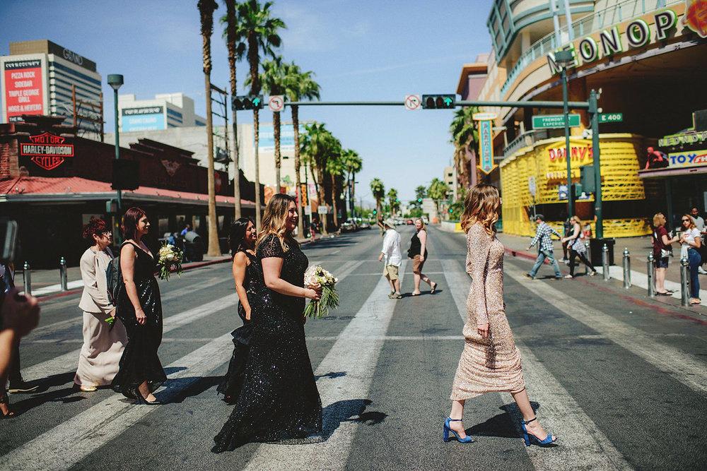 bride and bridemaids walking down old vegas