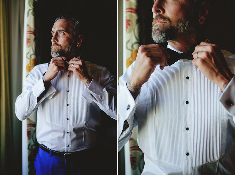 groom fixing bow tie
