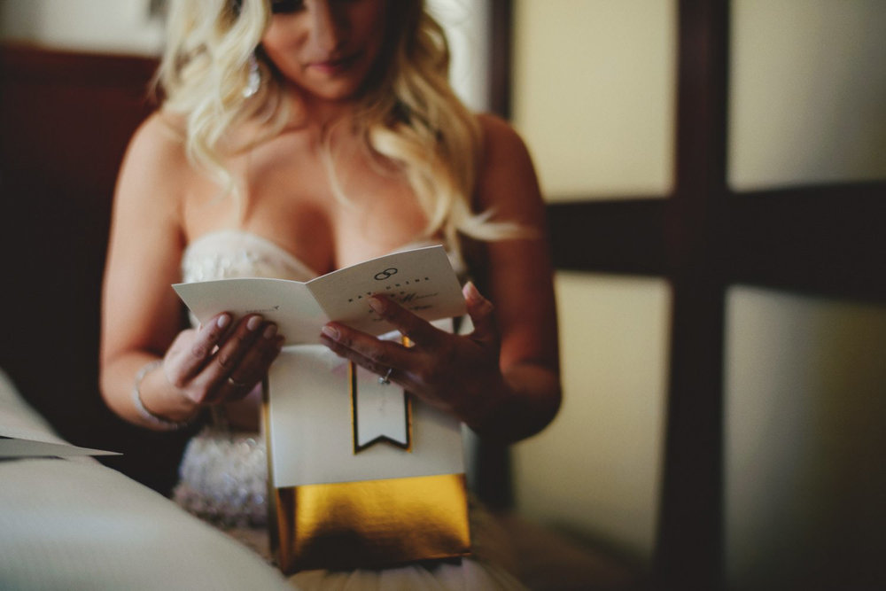 editorial ringling wedding: bride reading letter