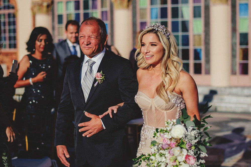editorial ringling wedding: dad walking bride down aisle