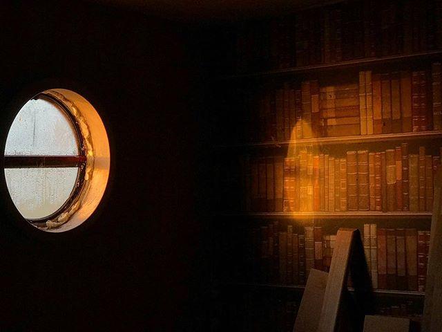 My unfinished window and bookshelf wallpaper. . . . #morning #light #sunrise #boat #dutchbarge #barge #porthole #book #books #window