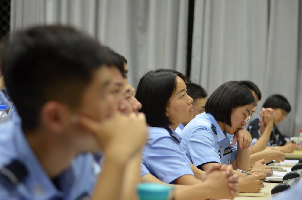 Students at People's Public Security University listening attentively