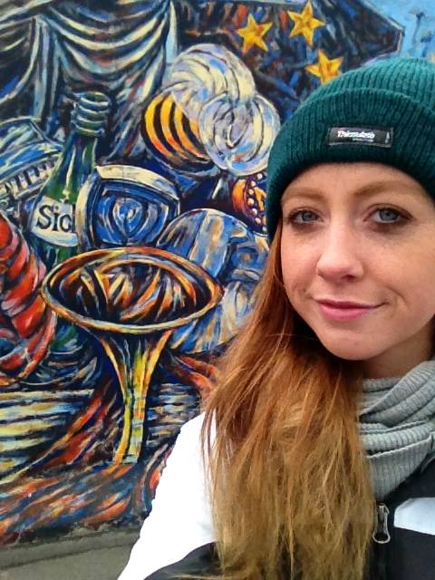 A selfie by the Berlin Wall.