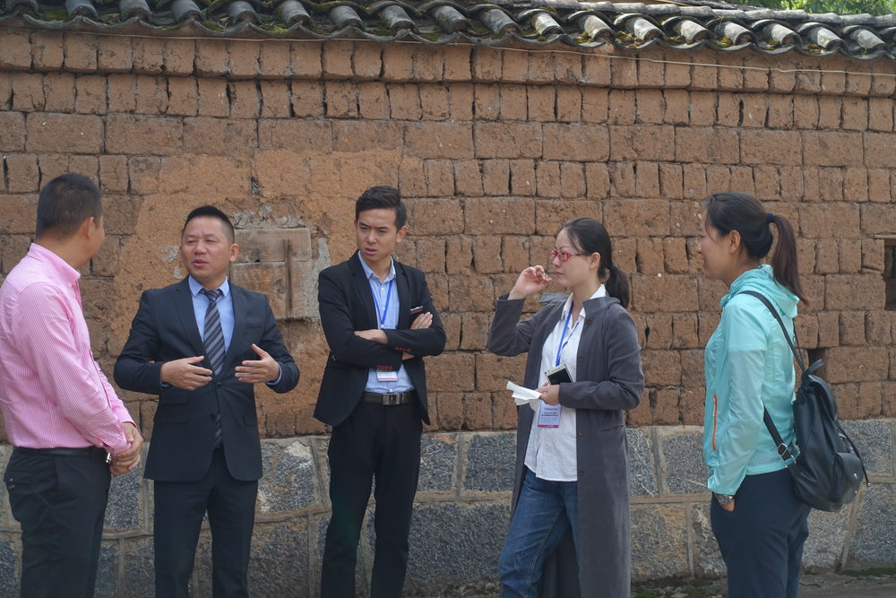Guests of the inauguration event networking in the GEC courtyard