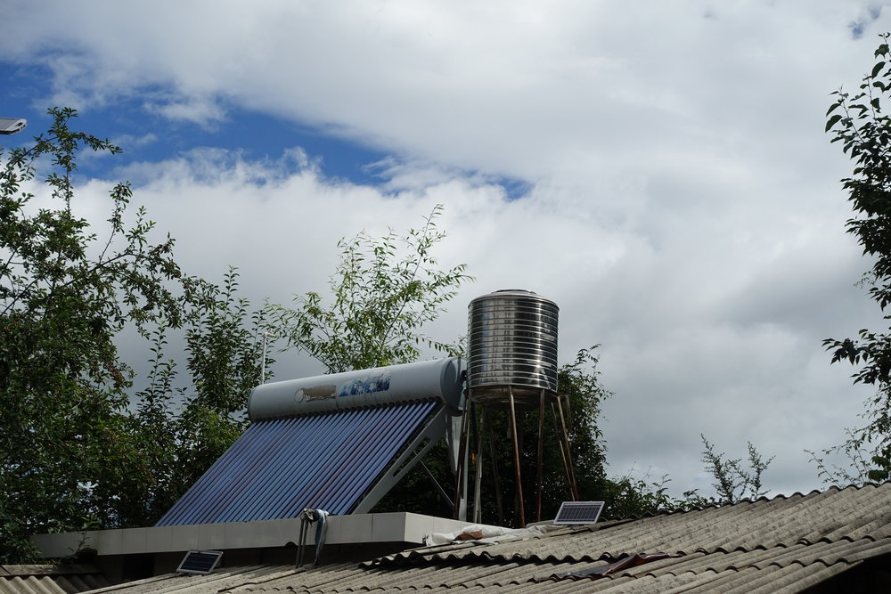 Solar water heater providing hot water for the house