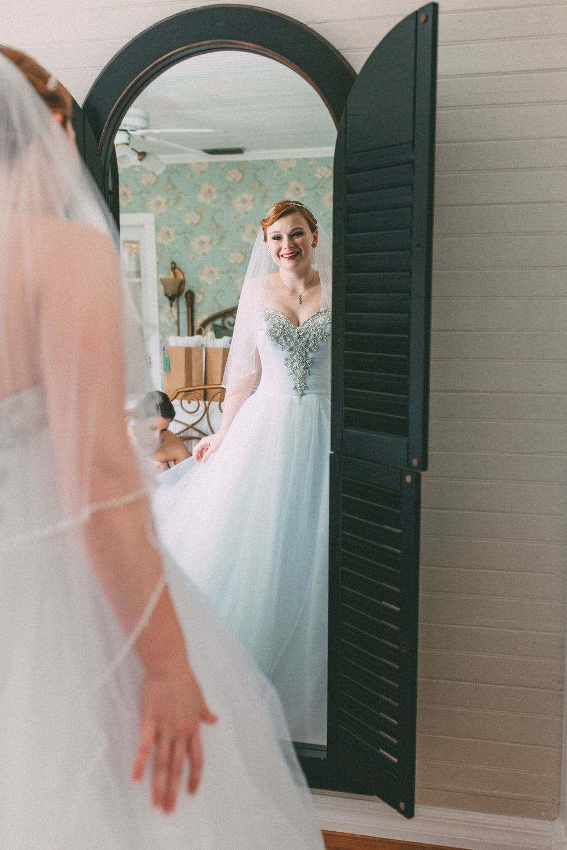 Up The Creek Farms, Palm Bay, Brevard County FL Wedding, bridal suite, bride in wedding dress in mirror photo