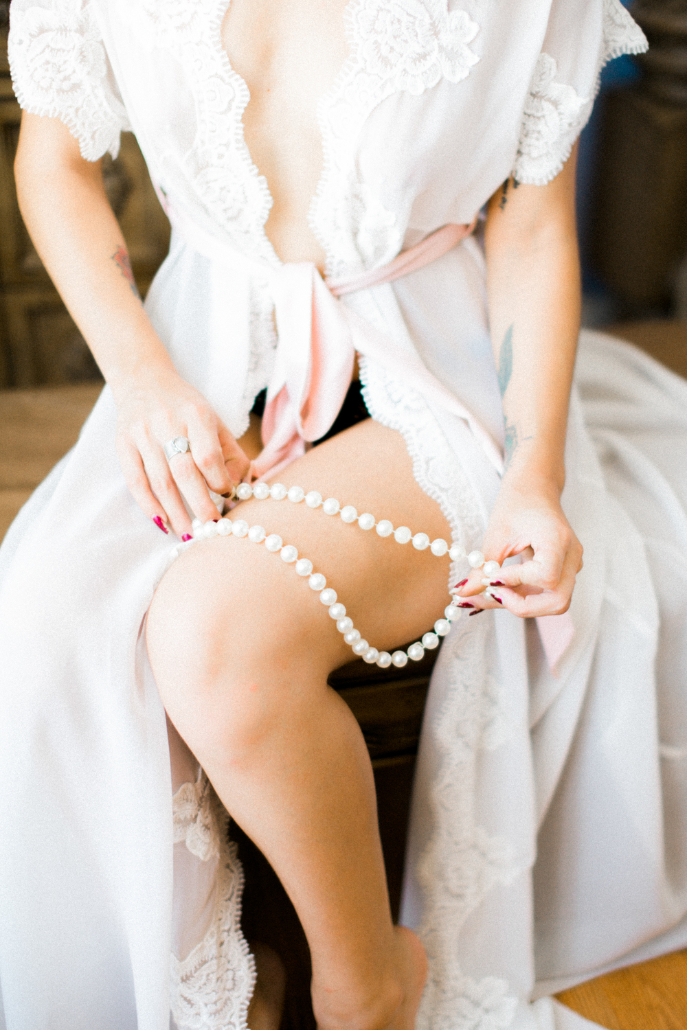 fine art boudoir model photo in melbourne fl robe and pearls