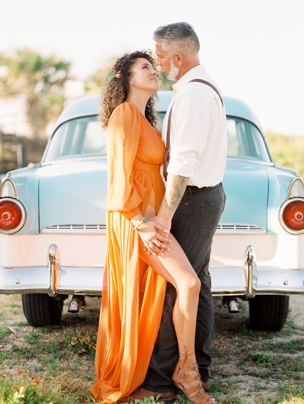 St. Augustine Beach A1A Anniversary Photos of stylish couple in vintage blue car