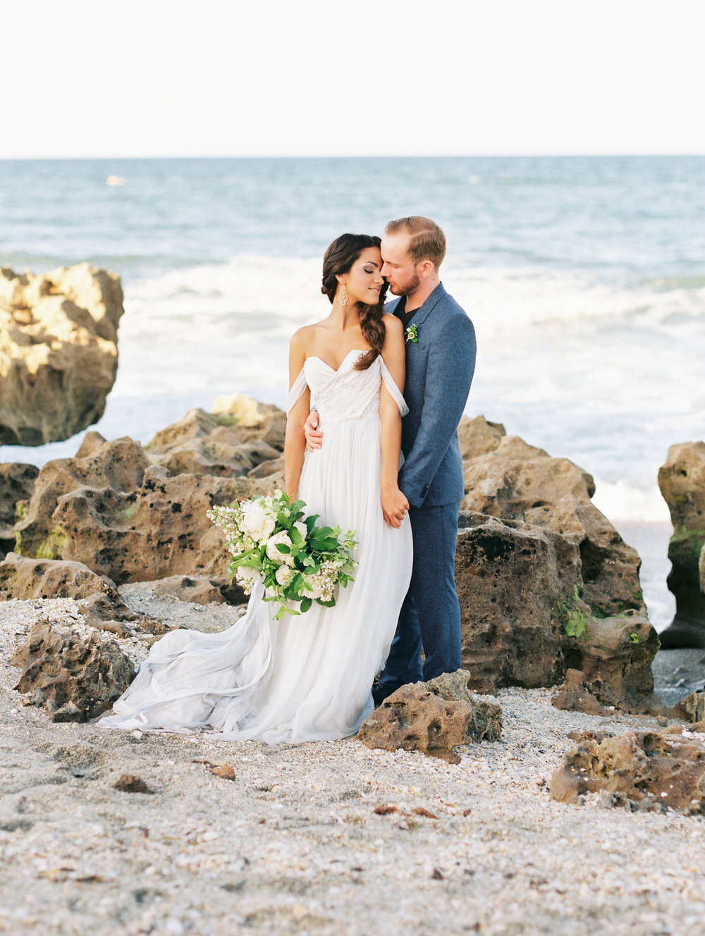 coral cove, jupiter beach FL, palm beach wedding photos, bride and groom on rocks