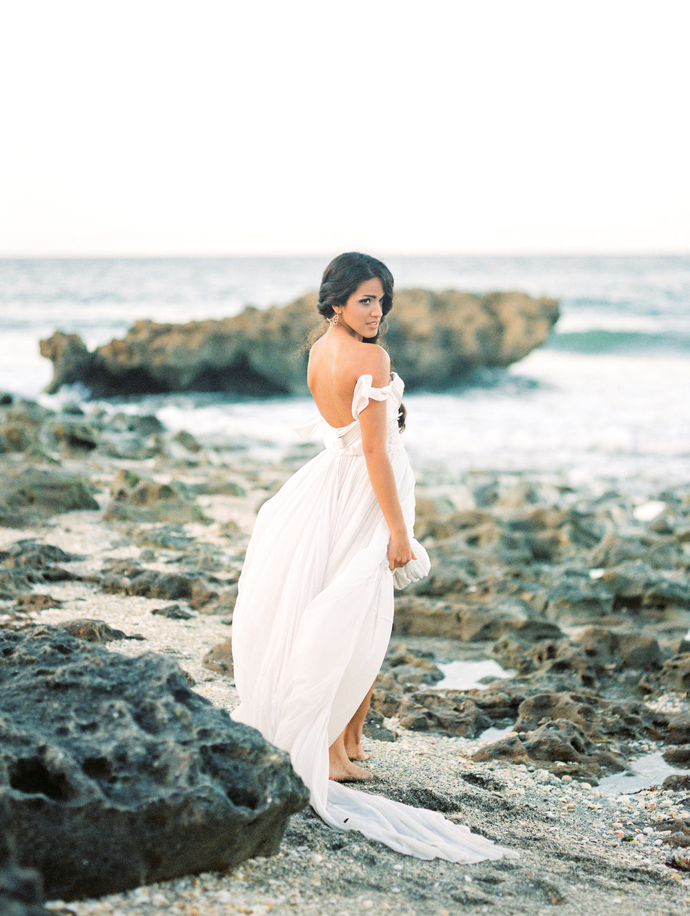 coral cove, jupiter beach FL, palm beach wedding photos, bride with flowing dress on beach
