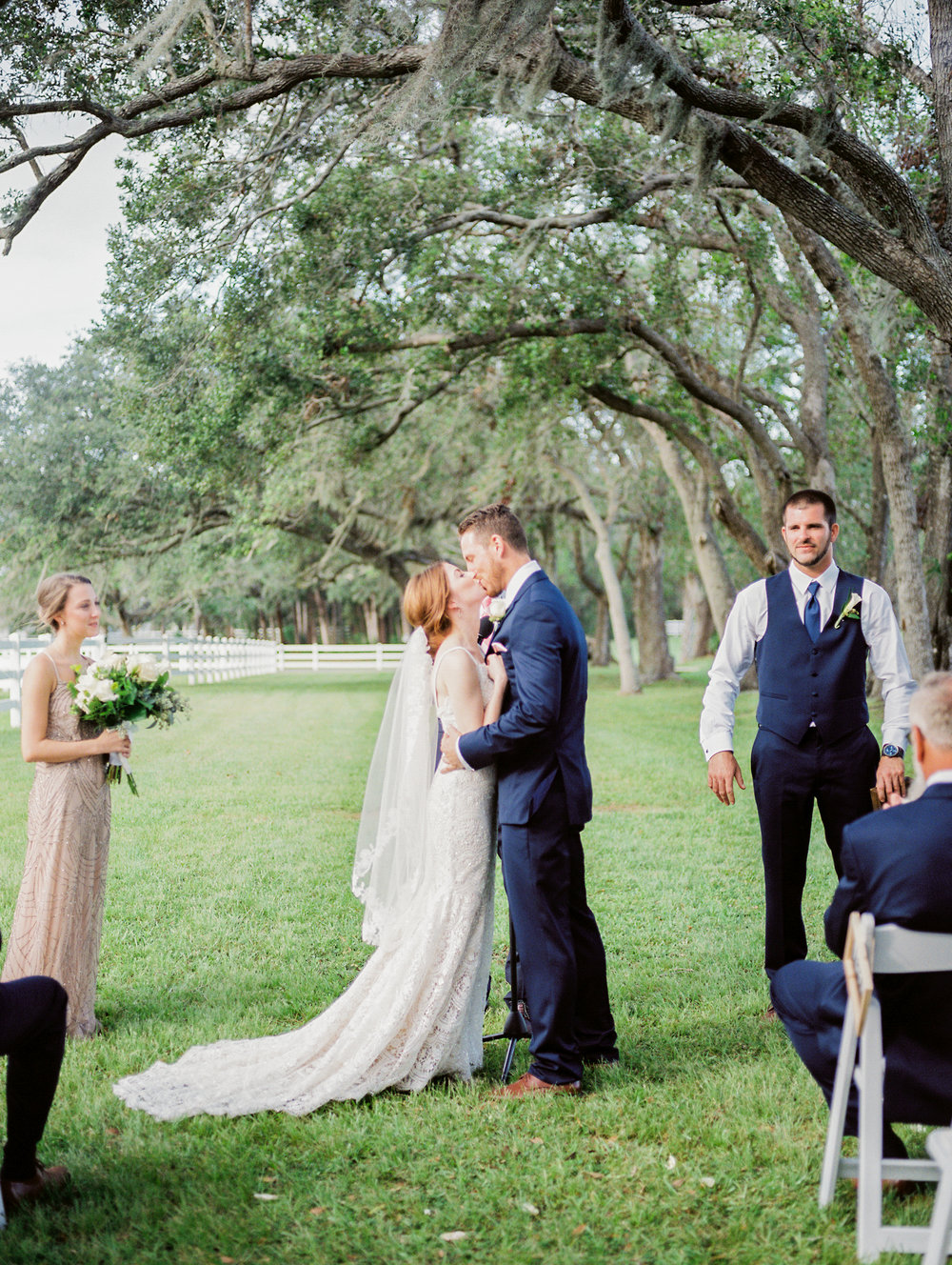 orlando florida wedding photos ceremony jessica bellinger photography first kiss