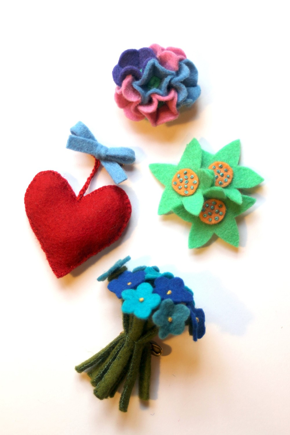 Designs Felt Brooches.JPG