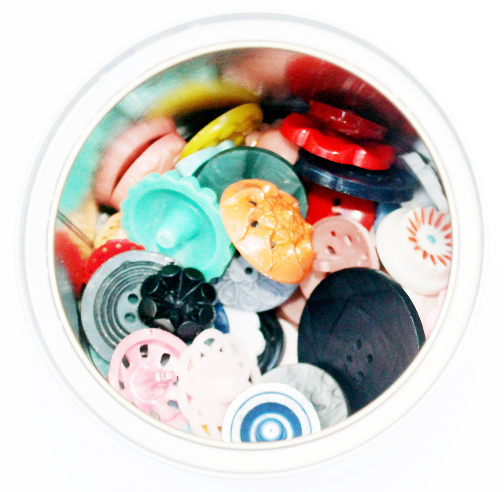 Buttons in a tin for booklet.jpg