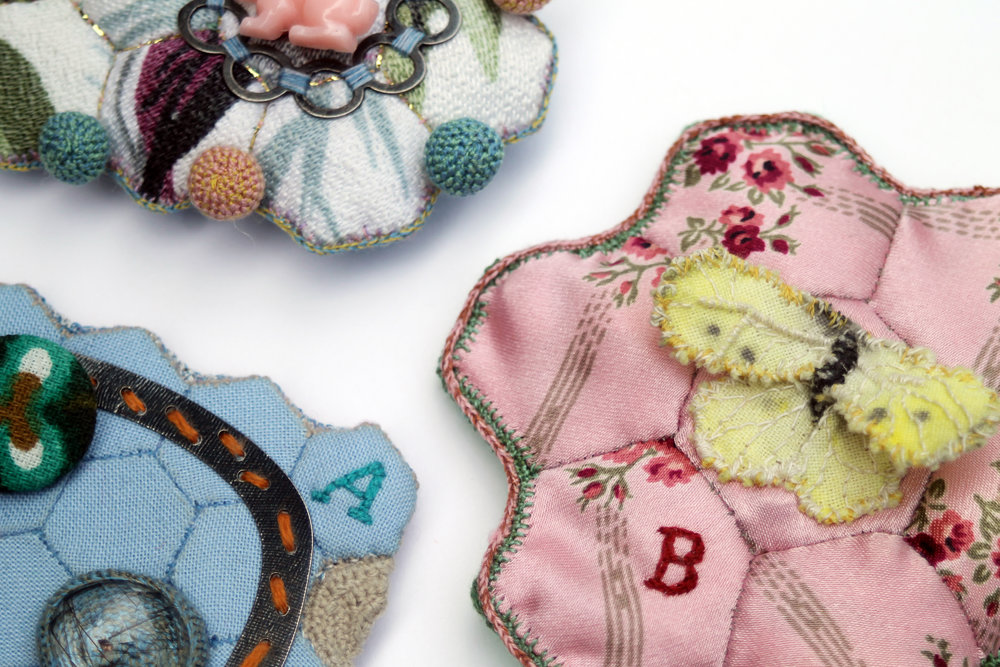 Sister brooches (details) for Louisa May Alcott