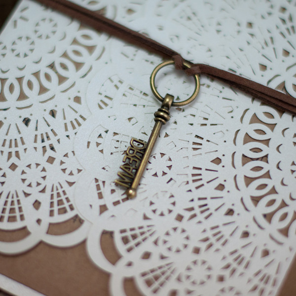 rustic laser cut invitation with key