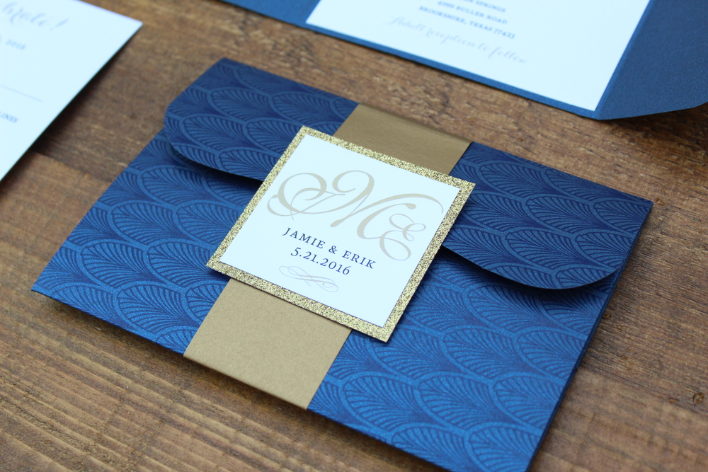 navy and gold pocket invitation with monogram belly band