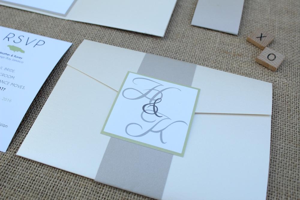 destination wedding pocket invitation suite with monogram belly band