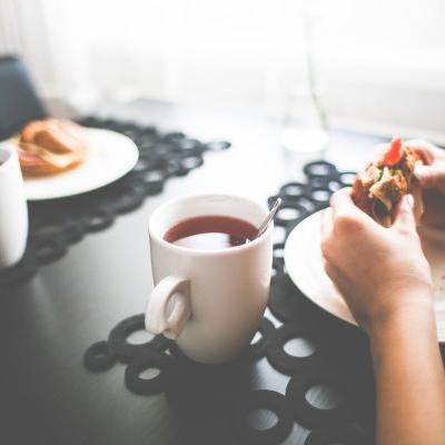 having-tea-hand