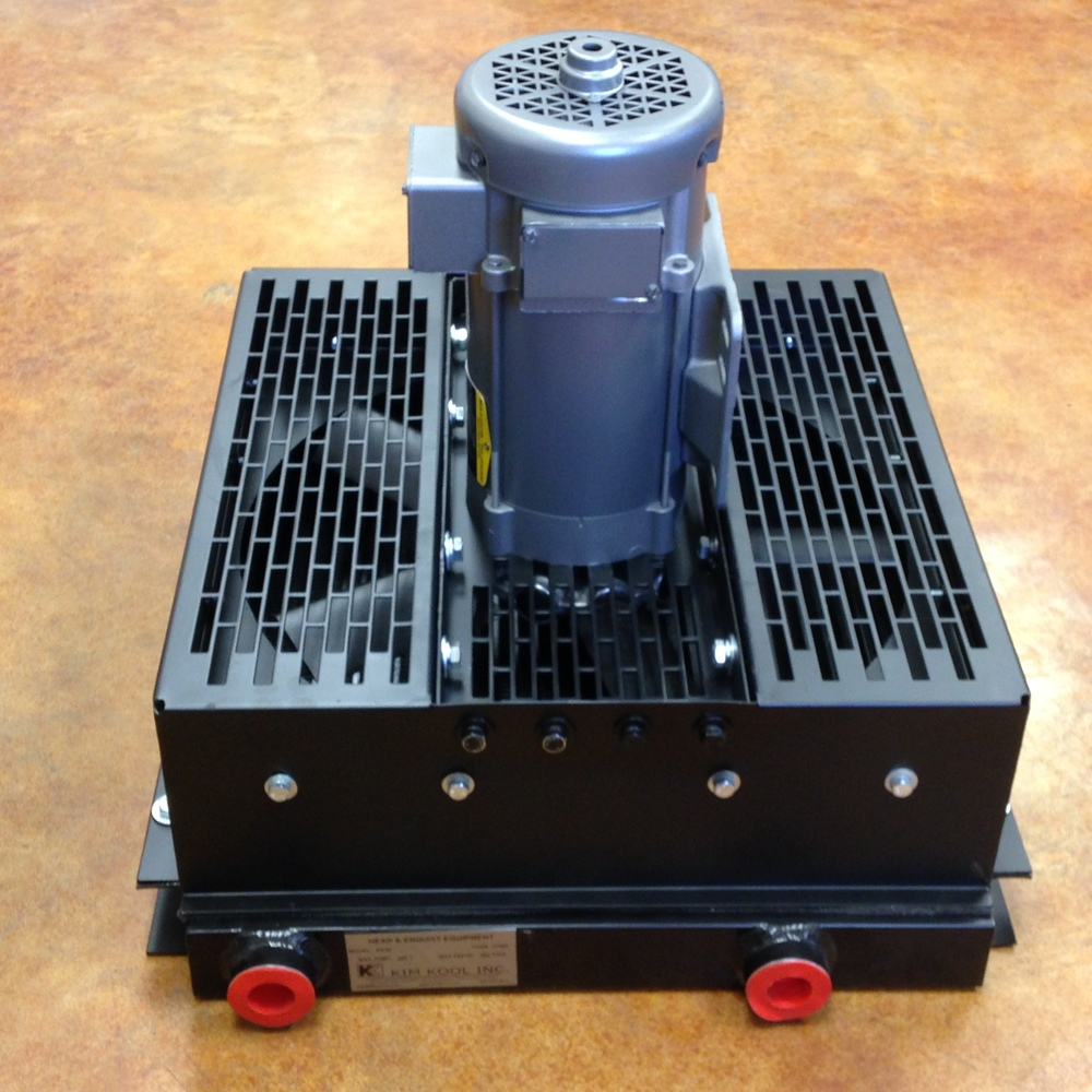 Aluminum oil cooler with 24 volt DC motor custom manufactured for auxilary cooling in a retrofit application.