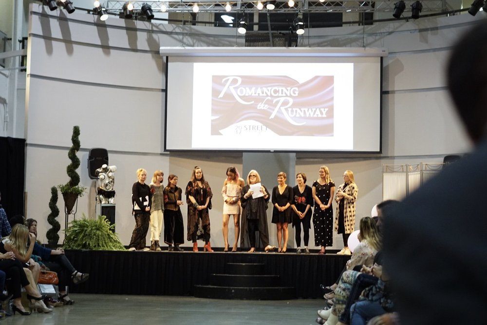 Romancing the Runway featured a hefty 9 designers, pictured here. Shout out to the guy who photo bombed this picture! :)
