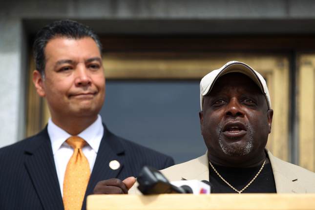 Dorsey Nunn, executive director of Legal Services for Prisoners with Children, speaks as California Secretary of State Alex Padilla looks on during a news conference at the Rene C. Davidson Courthouse in Oakland, Calif., on Tuesday, Aug. 4, 2015. Padilla announced on Tuesday that he's dropping the appeal of Scott v. Bowen, clearing the way for Californians who have been convicted of felonies to get the right to vote. (photo credit Anda Chu/Bay Area News Group for the Contra Costa Times) Found on LSPC website.