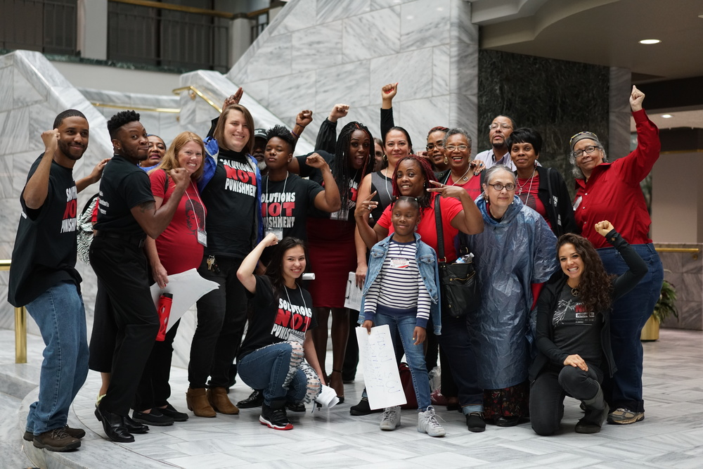 SNaP Co celebrates after successful hearing for the community created Pre-Arrest Diversion Initiative. The following month the full city council voted unanimously in support. Solutions Not Punishment Coalition (SNaP Co) is a project of RJAC.