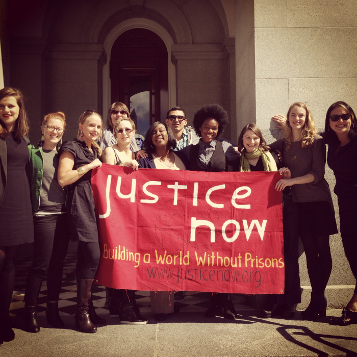 Justice Now members on the steps of the capitol after a legislative hearing for SB 1135, the Prison Anti-Sterilization bill, in 2014.
