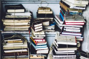book-pile-prison-writing_photo-by-unsplash-user-simson-petrol-300x200.jpg